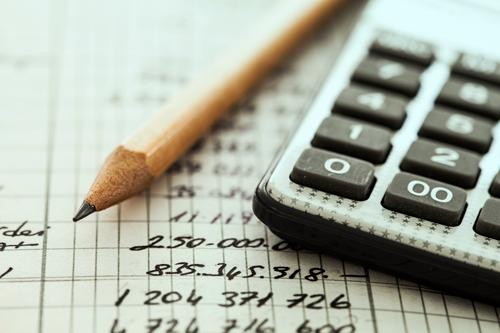 calculator, pencil and paper